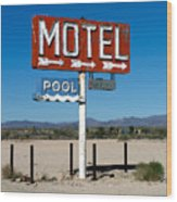Motel Sign On I-40 And Old Route 66 Wood Print