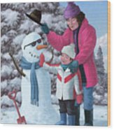 Mother And Child Building Snowman Wood Print