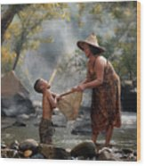 Mother And Son Are Happy With The Fish In The Natural Water Wood Print