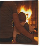 Mother And Son Sitting In Front Of A Firepalce Wood Print