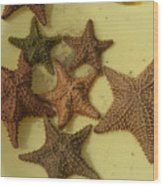 Multi-colored Star Fish On The Sand Wood Print