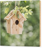 New Wooden Birdhouse Hanging On Tree Branch Outdoors  Wood Print
