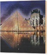 Night Glow Of The Louvre Museum In Paris Wood Print