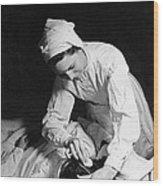Nurse Tending To A Patient Wood Print