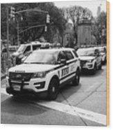 nypd police patrol vehicles parked at columbus circle New York City USA Wood Print