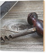Old Corkscrew And Wine Bottle In Background On Rustic Wood Wood Print