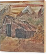 Old Farmhouse With Hay Stack In A Snow Capped Mountain Range With Tractor Tracks Gouged In The Soft  Wood Print