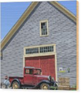 Old Ford Model A Pickup In Front Barn Wood Print