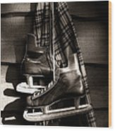 Old Hockey Skates With Scarf Hanging On A Wall Wood Print