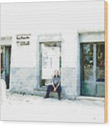 Old Man Sitting In Front Of A Shop Wood Print