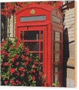 Old Red Telephone Box Or Booth Surrounded By Red Flowers In Toro Wood Print