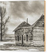 Old Rustic Log House In The Snow Wood Print