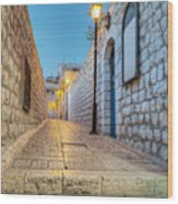 Old Stone Alleyway With Electric Lights Wood Print by Noam Armonn