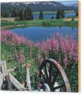 Old Wheel And Brooks Lake Wood Print by Kathy Yates