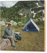 Older Man Resting In Backpacking Camp Wood Print