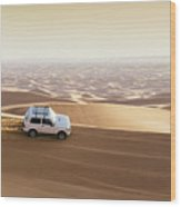 One 4x4 Vehicle Off-roading In The Red Sand Dunes Of Dubai Emirates, United Arab Emirates Wood Print