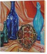 Orange Cloth Blue Bottles Wood Print
