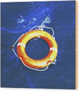 Orange Life Buoy In Blue Water Wood Print