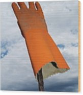Orange Rubber Glove On A Wooden Post Against A Cloudy Sky Wood Print