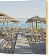 Parasol And Sunbeds At Sunset Wood Print