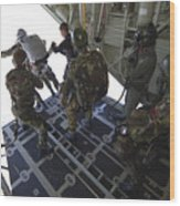 Paratroopers Jump From A C-130 Hercules Wood Print by Andrew Chittock