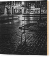Park bench on a rainy night Wood Print