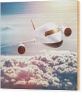 Passenger Airplane Flying At Sunset, Blue Sky. Wood Print