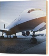 Passenger Airplane On The Airport Parking Wood Print