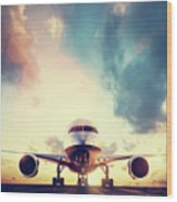 Passenger Airplane Taking Off On Runway At Sunset Wood Print