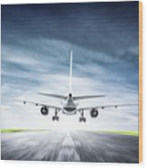 Passenger Airplane Taking Off On Runway Wood Print