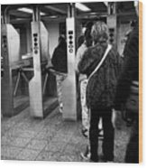 passengers moving through exit turnstiles in subway station New York City USA Wood Print