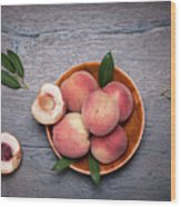 Peaches On A Dark Wooden Background Wood Print