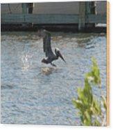Pelican On The Waves Wood Print