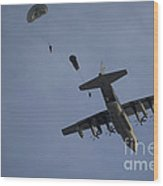 Personnel Jump From A C-130 Hercules Wood Print