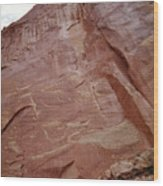 Petroglyphs On A Sheer Rock Wall Wood Print