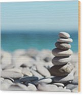 Pile Of Stones On Beach Wood Print by Dhmig Photography