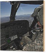 Pilot Operating The Cockpit Of A Uh-60 Wood Print