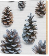 Pine Cones Looking Like Christmas Trees On White Snowy Backgroun Wood Print