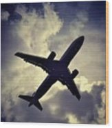 Plane Landing In London Wood Print
