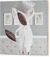 Playful Young Woman Jumping On The Bed , A Pillow Fight Wood Print