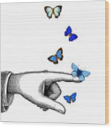 Pointing Finger With Blue Butterflies Wood Print