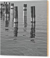 Poles In The Water Wood Print
