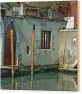 Poles On Canal In Venice Wood Print
