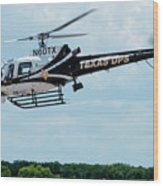 Police Helicopter Taking Off Wood Print