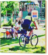 Police Officer Rides A Bicycle Wood Print