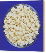 Popcorn In Glass Bowl On Blue Background Wood Print