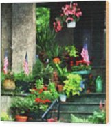 Porch With Geraniums And American Flags Wood Print