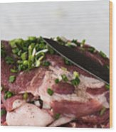 Pork meat with green garlik and knife Wood Print