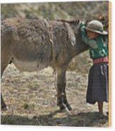Quechua Girl Hugging His Donkey. Republic Of Bolivia. Wood Print