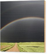 Rainbow And Darkened Skies Seen Down A Country Road Wood Print